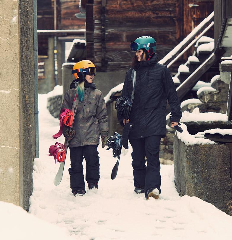 TSG winter 2019 photo shoot Leilani Ettel Kona Ettel Snowboarders walking in village