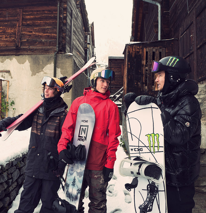 TSG winter 2019 photo shoot  Snowboarders and Freeskier walking in village Sass Fee