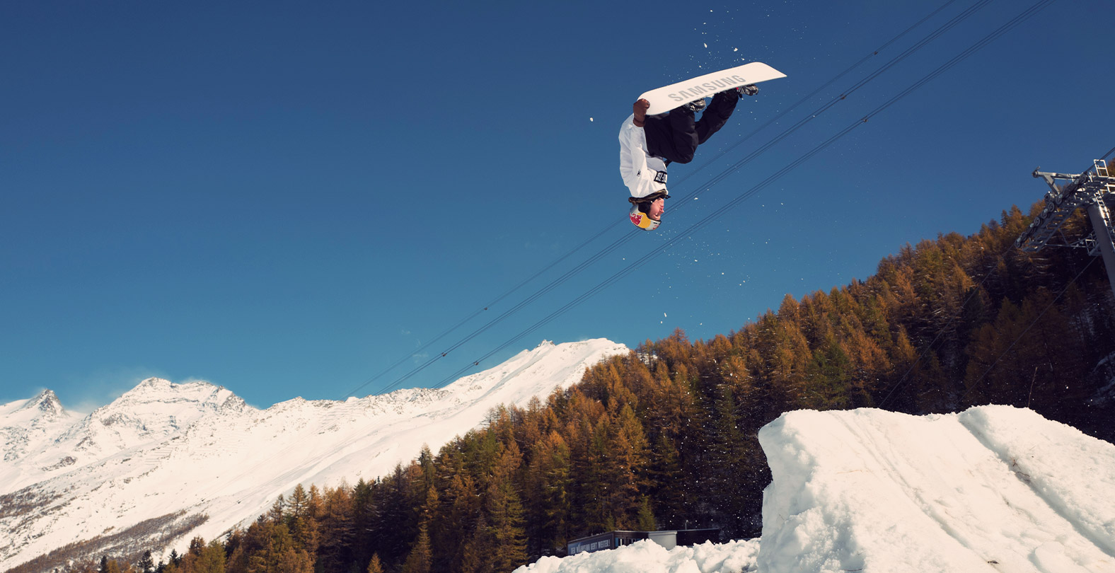 Snowboarder David Hablützel  with a BS Rodeo Nose Grab
