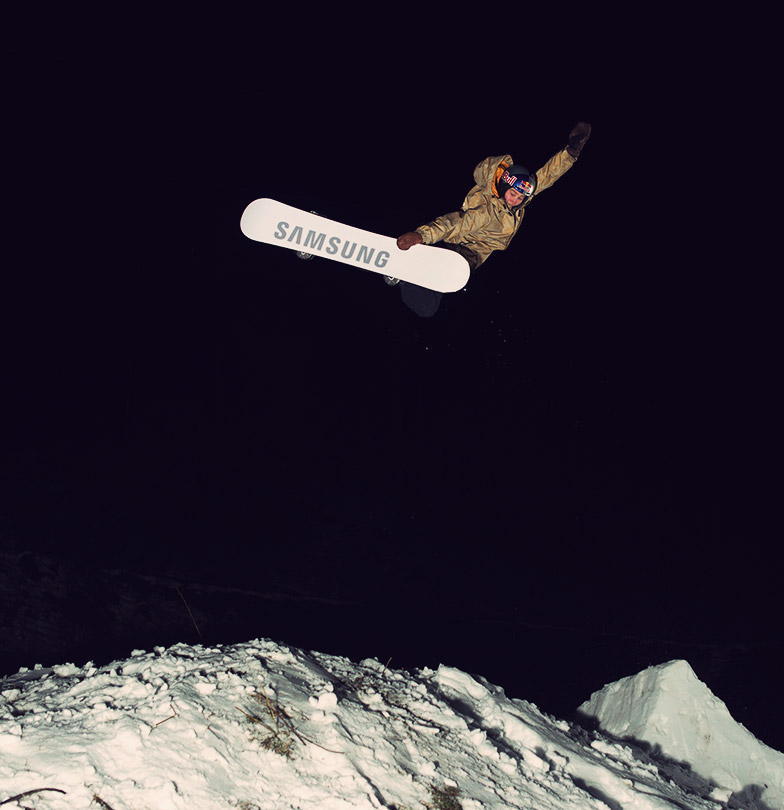 snowboarder David Hablützel with a BS Air night shooting in Saas Fee