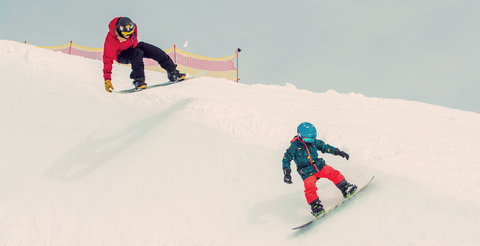 Gian Simmen snowboarding with his kids