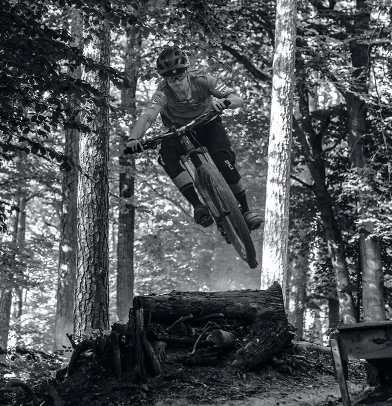Mountain biker Gerd Skant on a trail in the wood
