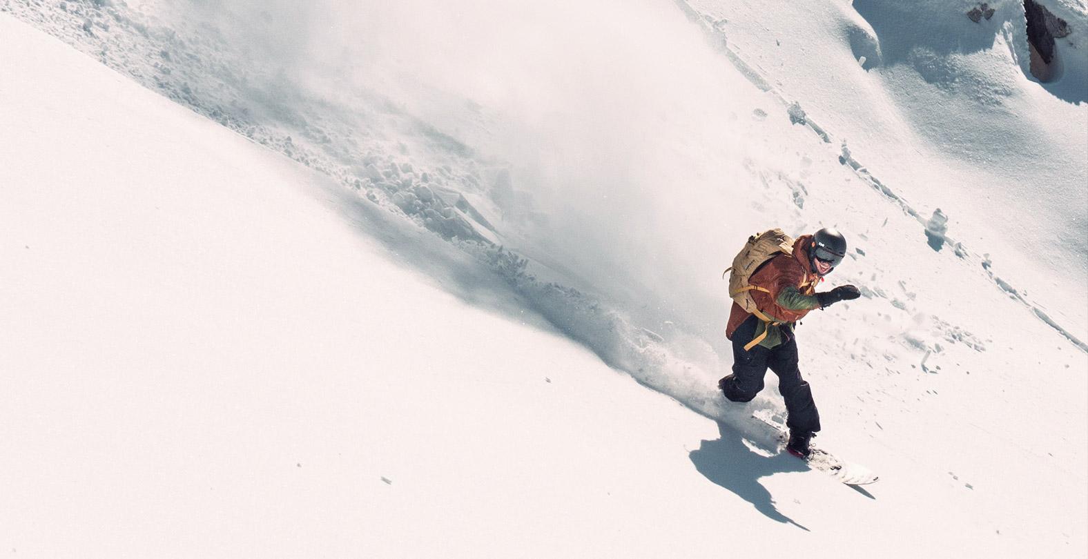 Gigi Ruef snowboarding powspray smile