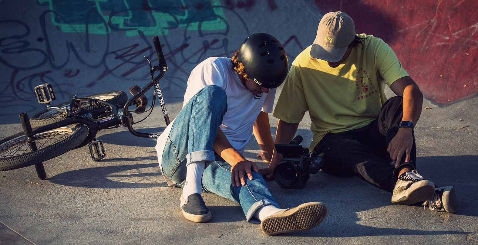 bmx rider and Filmer checking the footage